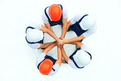 Large group of workers standing. In circle stock photos