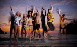 Large group of young people enjoying a beach party Royalty Free Stock Photo