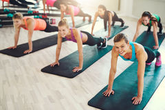 Large group of young women working out Royalty Free Stock Photos