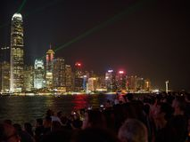 Large groups of people gather at the pier of Kownloon to admire the spectacle A Symphony. Kowloon, Hong Kong - November 02, 2017: Large groups of people gather stock images