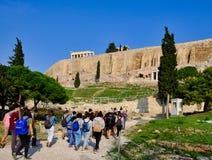 Large Guided Tour Group, Acropolis Slopes, Athens, Greece. A large guided tour group walking towards the Acropolis and Parthenon along a path on the Acropolis royalty free stock photos