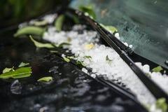 Large hail ice balls on car hood royalty free stock photos