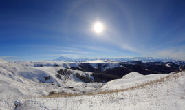 Large halo around the sun on a winter day in mountains Elbrus. N Royalty Free Stock Images