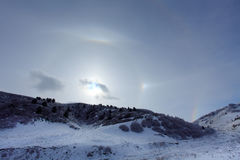 Large halo around the sun on a winter day in mountains. Hasaut v Royalty Free Stock Image