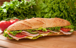 Large ham & swiss submarine sandwich. Stock Photography