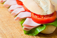 A large ham and tomato baguette Stock Image