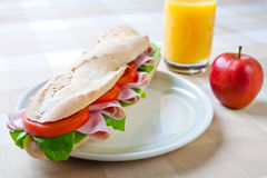 A large ham and tomato baguette Stock Images