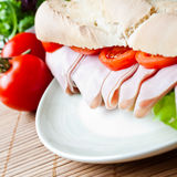 A large ham and tomato baguette Royalty Free Stock Photography