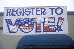 Large hand painted sign reads Register to Vote Stock Photography