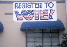 Large hand painted sign reads Register to Vote, CA Royalty Free Stock Images