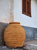 Large Terracotta Urn Outside Galaxidi House, Greece royalty free stock images
