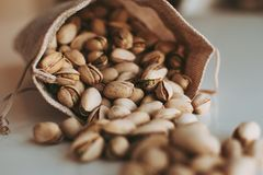 Large handful of pistachios stock image