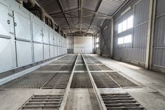 A large hangar with a floor made of steel gratings. stock image