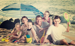 Large happy family on beach sitting on weekend Stock Photos