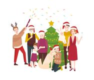 Large happy family celebrating Christmas. Smiling cartoon people in santa hats standing around spruce tree decorated by. Garlands. Holiday party. Festive Stock Photo
