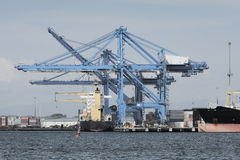 Large harbor cranes at a commercial dock Royalty Free Stock Photo