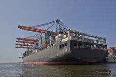 Large harbor cranes loading container ships in the port of Rotte Royalty Free Stock Photography