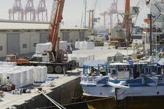 Large harbour crane loading cargo on a vessel at the Port of Salalah, 21 October, 2014, Salalah Stock Photography