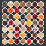 Large Health Food Collection. With ingredients for a healthy heart with vegetables, fruit, nuts, seeds, cereals, grains, pulses, spice and medicinal herbs. High royalty free stock photos