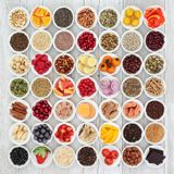 Large Health Food Collection. For a healthy heart with fruit, fish, vegetables, nuts, seeds and cereals with spices and herbs also used in herbal medicine. High stock images