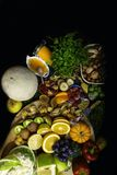 Large health food selection with foods high in antioxidants and vitamin c wooden black background, copy space. Health and super food to boost immune system, high royalty free stock photos