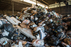 Large heap of garbage inside a waste plant.  Royalty Free Stock Photos