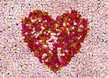 Large heart formed of many small hearts. Heart shaped from many small ones isolated on white love concept Royalty Free Stock Photos