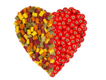 Large heart made of colorful pasta noodles and Tomatoes Stock Photos