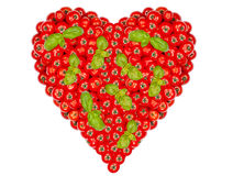Large heart made of many Tomatoes and basil Stock Images