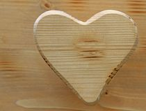 Large heart symbol inlaid in wood Stock Image