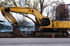 Large Heavy Construction Equipment Idle Downtown Site Stock Photo