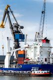 Large heavy-duty container ship in the port of Rotterdam, Nether Stock Photography