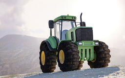 Large heavy duty green tractor on a mountain Stock Photography