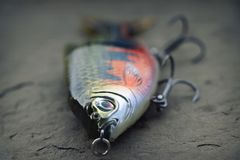 Large, heavy fishing glider lure plug for muskies. Large Savage Gear lure is primarily used for fishing for large species of fish such as muskie, big bass or royalty free stock images