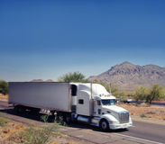 Large heavy goods freight truck speeding through A Stock Photos