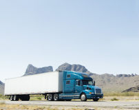 Large heavy goods freight truck speeding through A. Large heavy goods freight truck speeding through mountain and desert area of Arizona Stock Images