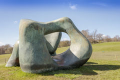 Large Henry Moore sculpture. WAKEFIELD, YORKSHIRE, UK - APRIL 19, 2016:  Large two forms bronze sculpture by Henry Moore in Yorkshire Sculpture Park Royalty Free Stock Images
