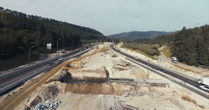 Large highway construction site with workers and heavy tools stock video