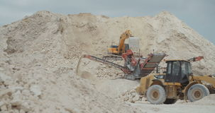 Large highway construction site with workers and heavy tools stock footage