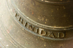 Historic brass bell labelled with the Cuban town name of `Trinidad` Royalty Free Stock Image