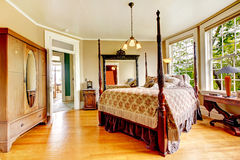 Large historical bedroom with antique bed. Stock Photo