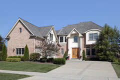 Large home with arched entry Royalty Free Stock Photo