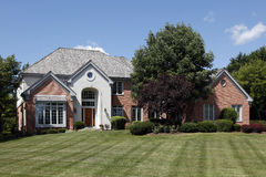 Large home with arched entry Stock Photos