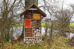 Large home made insect hotel Royalty Free Stock Photo