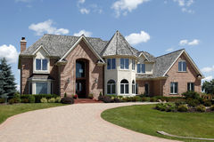 Large home with turret royalty free stock photos