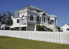 Large home with white fence Stock Photography