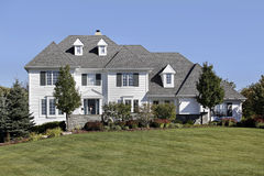 Large home with white siding Stock Photos
