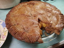Large homemade apple pie with one piece cut out Royalty Free Stock Images