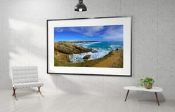 Large horizontal frame hanging on a white concrete wall 3D rendering royalty free illustration