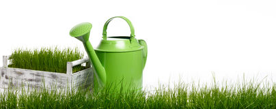 Large horizontal strip of grass and garden tools Stock Photos